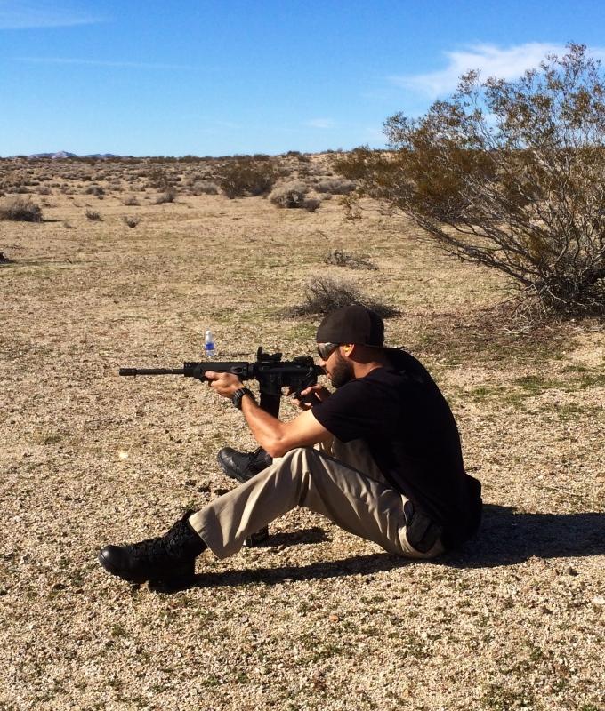 Me shooting grape soda cans in the Mojve desert